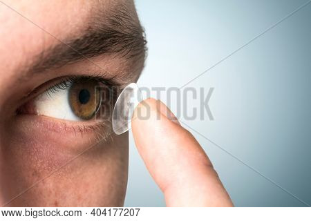 Man applying his contact lens