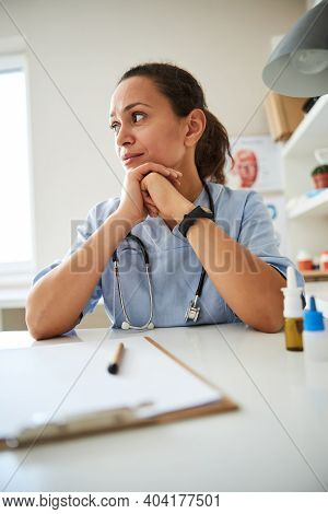 Latin-american Therapeutist Is Sitting Deep In Thoughts