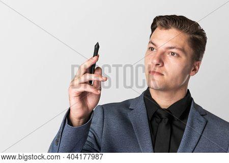 Businessman holding his digital pen