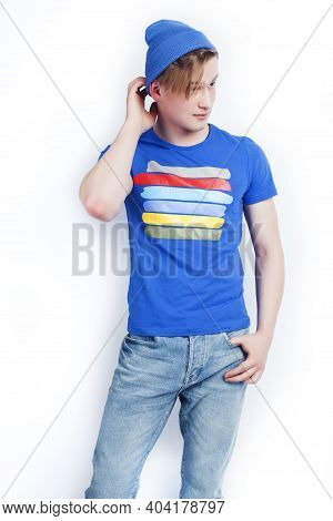 Young Handsome Teenage Hipster Guy In Hat Posing Emotional, Happy Smiling Against White Background I