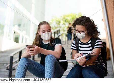 High school students in the new normal studying on stairway