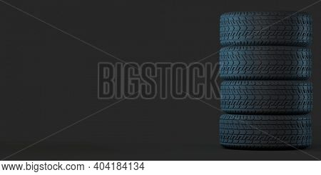 Four tires stacked on top of each other. Good graphics for use as a background or banner for a tire store, storage room, tire service. 3d illustration on dark