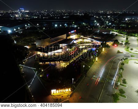 Aerial Drone View Of Modern Building In Jakarta Central Business District At Night With Jakarta City