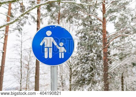 Blue Sign Parental Supervision Or Walking Area In The Winter Forest Outdoors