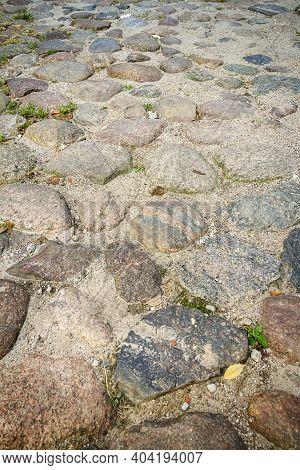 Old Granite Cobblestone Texture Background. Granite Cobblestoned Pavement. Stone Pavement Texture In