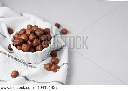 Natural Organic Roasted Hazelnuts Unpeeled On A Light Background, Copy Space. Basis Of Norm Fats And