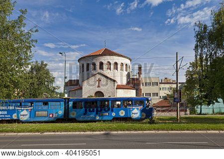 Sarajevo, Bosnia And Herzegovina - May 25 2019: A Blue Tramway Passing In Front Of The Serbian Ortho