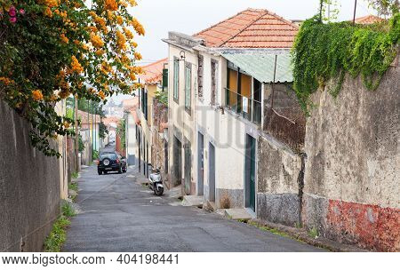 Funchal, Portugal - August 24, 2017: Street View With Small Living Houses And Parked Car, Funchal Ol