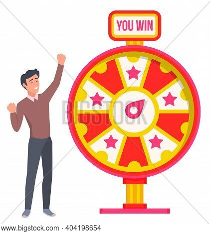 Happy Smiling Man Winning Prize. Spinning Wheel Of Fortune With Red And White Sectors And Stars. Luc