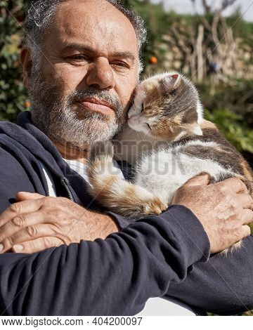Bearded Mature Man Happy Holding And Hugging His Cute Cat. Friendship, Love, Love Of Animals, Affect