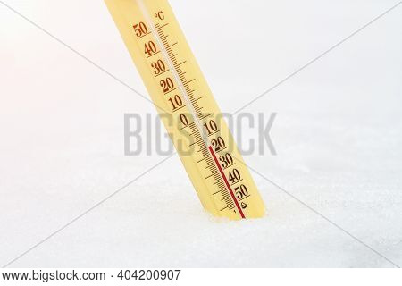 Wintertime. Thermometer In The Snow Shows Very Low Temperatures. Fifteen Degrees Under Zero Celsius.