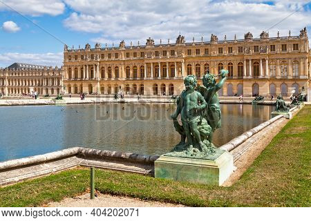 Versailles, France - August 20 2017: Bronze Statue Of Three Cherubs Placed On The Edge Of A Basin Of