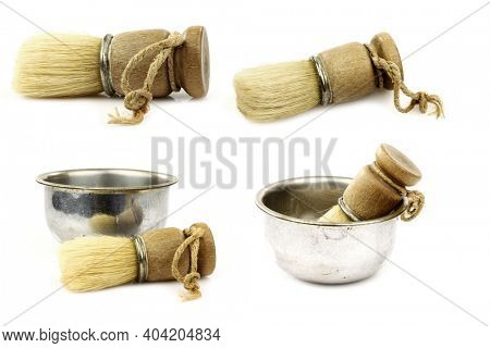 vintage shaving brushes and some in a metal shaving bowl on a white background