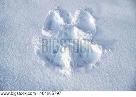 Snow Angel In The Fresh Snow. Trace From The Childs Body.