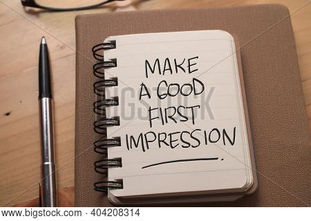 Make A Good First Impression, Text Words Typography Written On Book Against Wooden Background, Life