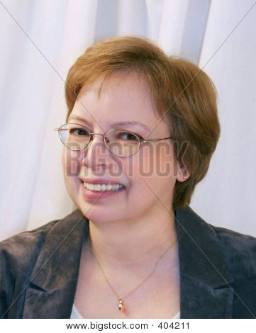 Headshot Of Woman Over Blue