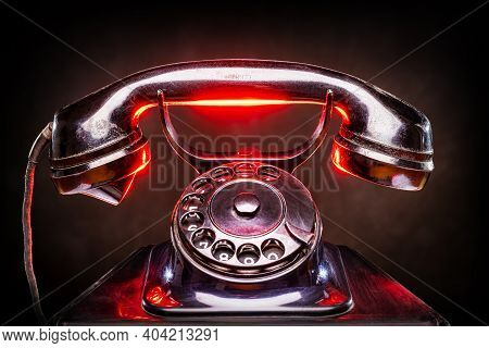 Vintage Phone With Red Highlights Against Black