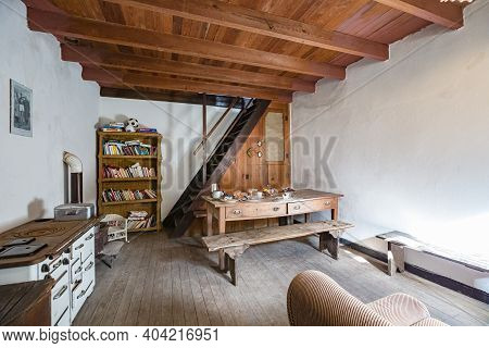 Cassagna, Genoa, Italy - October 2020: Old-fashioned Sitting Room With Vintage Wooden Furniture In O
