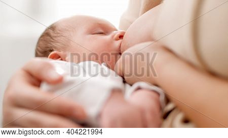 View From Above On Newborn Baby Boy Sucking Milk From Mothers Breast. Concept Of Healthy And Natural