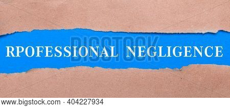 A Strip Of Blue Paper With The Words Professional Negligence Between The Brown Paper. View From Abov