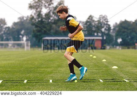 Junior Football Club Player Training On Soccer Ladder. Football Training For Sport Team. Young Boy R