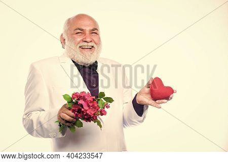 True Love. Happy Mature Man Hold Flowers And Heart. Love And Romance. Health Care Treatment. Problem