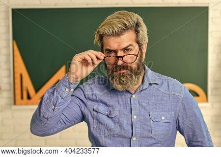 Serious Bearded Teacher In Glasses. Back To School. Develop Logic And Creativity. Start The Brain En