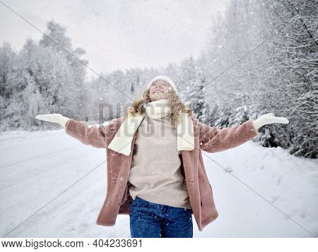 Happy Young Woman Plays With A Snow In Winter Day. Girl Enjoying Winter, Frosty Day. Playing With Sn