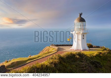 Cape Reinga Lighthouse In New Zealand During Wonderful Evening Light.