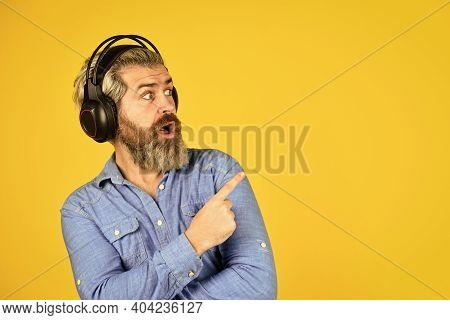 Popular Music Playlist. Man Bearded Hipster Headphones Listening Music. Singer On Rehearsal. Hipster