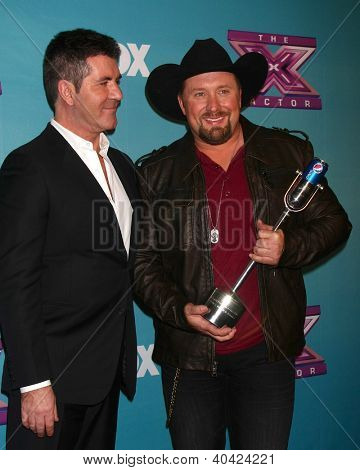 LOS ANGELES - DEC 20:  Simon Cowell, Tate Stevens - Winner of 2012 X Factor at the 'X Factor' Season Finale at CBS Television City on December 20, 2012 in Los Angeles, CA