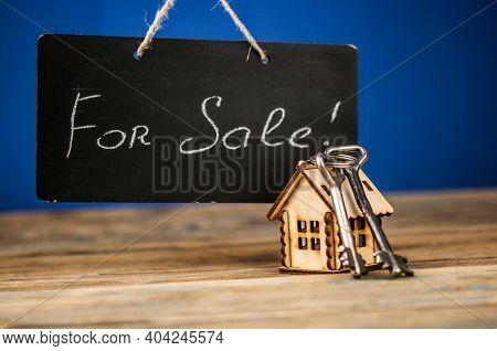 Real Estate Concept. House for sale. Real old blackboard write for sale with miniature house