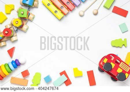 Children's Toys Made Of Natural Wood On White Background. Multi-colored Pyramid, Train, Constructor,