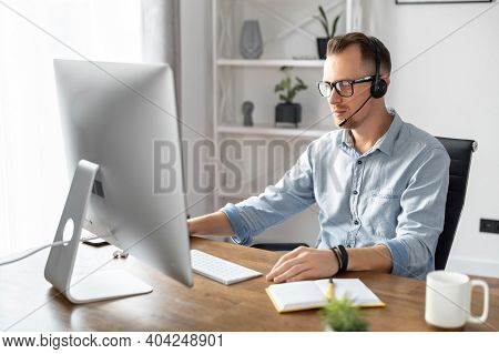 A Confident Businessman, Office Employee, Call Center Worker Is Using Hands Free Headset For Talking
