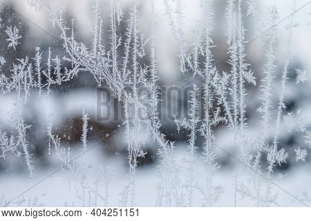 A Cold And Frosty Winter Morning Through A Window With Icy Patches, Crystal Painting On Glass. Close