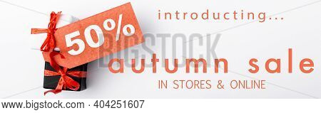 Small Gift Boxes With Price Tag And 50 Percent Sign Near Introducing, Autumn Sale, In Stores And Onl