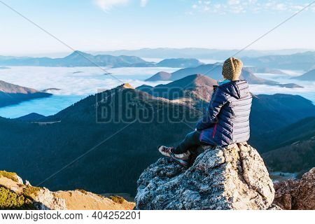 Young Woman With Backpack And Trekking Poles Having A Hiking Walk On The Umbwe Route In The Forest T