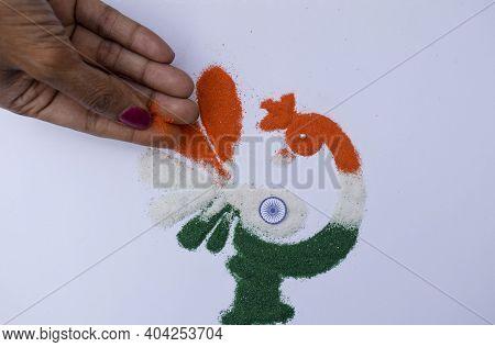 Female Making Rangoli Design Of Tricolored Design Saffron White And Green On Occasion Of Indian Repu