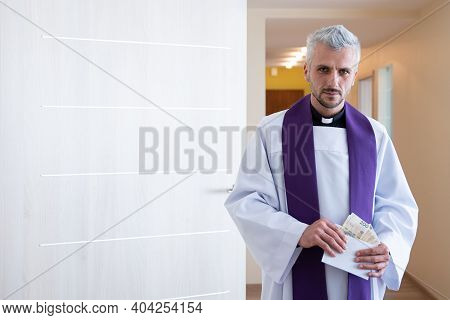 Polish Catholic Priest Holding And Counting Money During Pastoral Visit