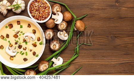 Mushroom Soup With Croutons, Onions And Spices. On A Wooden Background. Top View. Copy Space.