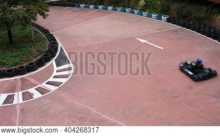 Racetrack In The Outdoor With A Racecar Passing By Horizontal Composition