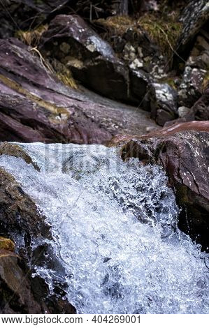 Detail Of A Mountain Torrent Of Crystalline Water Flowing Between Rocks, Vertical