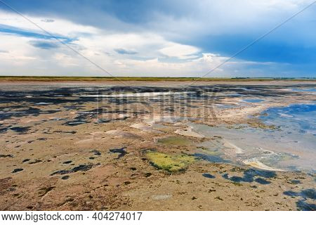 Shore Of Lake Ebeyty, Therapeutic Mud, Salt Lake In Omsk Region, Russia. Natural View Of Pond And Bl