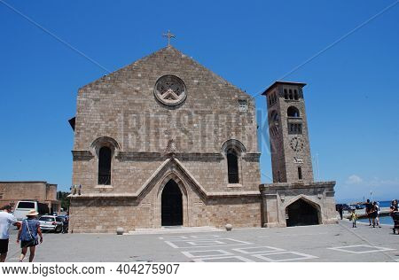 RHODES, GREECE - JUNE 9, 2019: The Church of Evangelismos (Church of Annunciation) by Mandraki harbour in the Old Town of Rhodes island. The Gothic style church was built in 1925.
