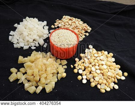 Pile And Heap Of A Makara Sankranti Or Pongal Home Made Raw Sweet Distribution Food In A Black Backg
