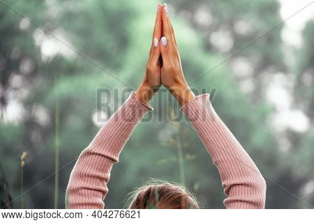 Close-up Of Hands Joined Together In A Namaste Gesture Against A Backdrop Of Nature. Mental Health A