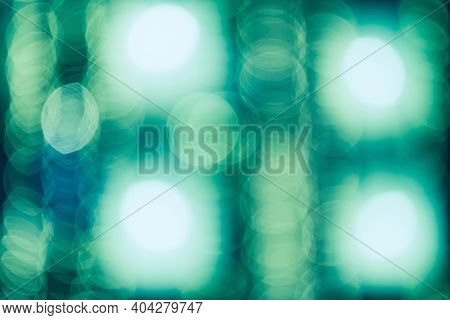 Abstract Bokeh Green Blurry Background. Green Sparkling Lights Festive Background With Texture. Abst