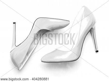 Beautiful Female Shiny White Stilettos On A White Background