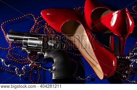 Beautiful Patent Leather Shiny Female Red Stilettos, Revolver And Beads