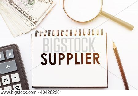 Supplier - Text Written On A Notebook With Office Background.